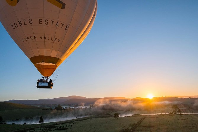 Greet the morning sun as you take flight over the Yarra Valley and its vineyards on a Yarra Valley hot air balloon flight. You'll fly for approximately one hour before completing the memorable experience of ballooning in the Yarra Valley with an optional sumptuous sparkling buffet breakfast at Balgownie Estate.