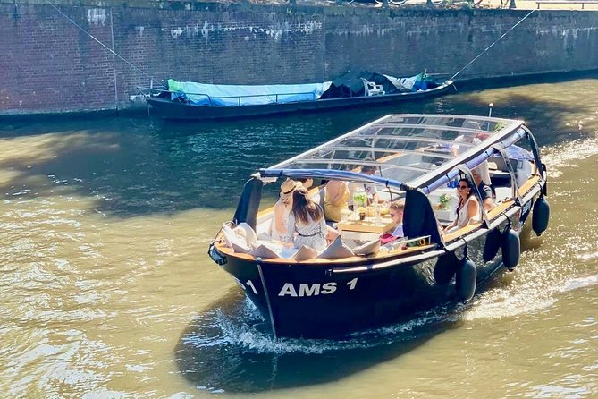 Do you want to experience Amsterdam in a more authentic way? Step aboard on our beautiful large luxury sloop with enough space for everyone and discover the city like a real explorer. <br><br>We'll welcome you on our stylish, electric sloop with unlimited drinks and delicious Dutch snacks and we will also stop at one of Amsterdams best boat catering to pick up real Amsterdam 'bitterballen'. So lean back, relax en listen to our amazing stories about the secrets of Amsterdam.<br><br>During our tour there is always a lot of interaction between the guests and our captain, because we always have a maximum of 12 guests aboard. This guarantees you a personal and amazing experience in the historical city of Amsterdam. You will cherish memories that you won't forget. Of course children are welcome!<br><br>Did you know that in 2019 Amsterdam experience cruise became one of the most popular and best reviewed Airbnb experiences? We are currently number 3 in the world with the most positive reviews and bookings