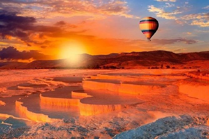 Get a unique view of Pamukkale from the air on this hot air balloon flight. Enjoy a breakfast of coffee, tea, and snacks before you board your balloon. Slowly fly over the white travertine pools of Pamukkale and the ancient ruined city of Hierapolis. Upon landing, enjoy a glass of champagne. Hassle-free pickup and drop-off from your hotel or port Snap photos of Pamukkale and Hierapolis from above Enjoy a light breakfast before take-off Sip a champagne toast upon landing<br><br>