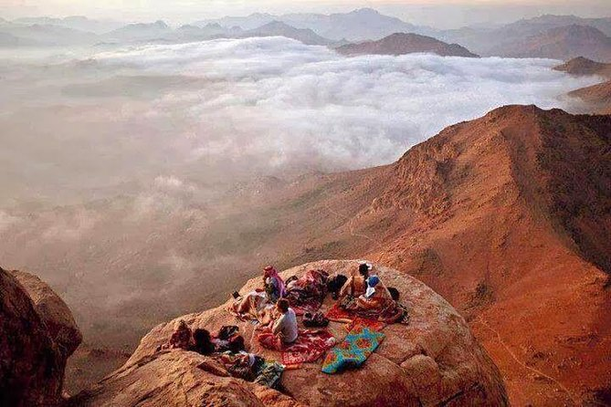 Watch the sunrise from the top of Mount Sinai on a hiking trip from Sharm el Sheikh to one of Egypt's highest mountains. You'll climb the 7,497-foot (2,285-mt.) peak in the predawn darkness, see first light illuminate the mountaintop chapel and mosque, then descend to the 6th-century Monastery of St. Catherine, where Moses has seen the Burning Bush, as believed. With round-trip transport from Sharm el-sheik, this is a great way to experience Mount Sinai and St. Catherine even if you have limited time in Egypt.