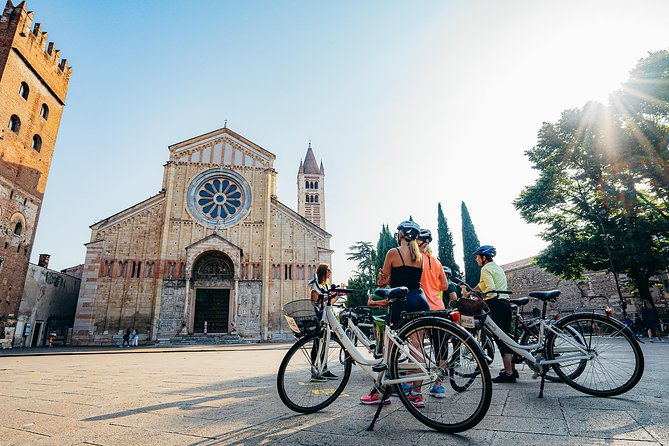 Join our Verona Bike Tour and follow your local guide around the main squares and ancient monuments of Verona on an easy three-hour ride that will give you a great overview of the city in a short time. Jump on one of our bikes, fasten your helmet and listen to the passionate story your guide will tell you. You will discover the old town and its most remarkable tourist spots while riding through cobbled lanes and along the majestic city walls. Our Verona bike tour is passion and culture: Roman ruins, stories and tales about the past and the present of this wonderful city. The Arena amphitheatre, Castel San Pietro, Capulets' house and the famous balcony where you will have the chance to delve into Romeo and Juliet's love story: these are just some of the unforgettable experiences we will live together during our bike tour. We are waiting for you!