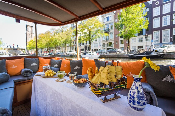 On this 1h15min All-In Luxury Classic River Boat Cruise, you will explore the city, its famous landmarks, culture, and rich trading history whilst relaxing with a drink in your hand. During the cruise, our skipper will take you through many highlights our city has to offer and our hostess will provide you with drinks and Dutch Gouda cheese. The cruise is live guided, so expect an interactive tour, with enough space for questions and any needed recommendations for your further stay in Amsterdam. All tours are in ENGLISH.