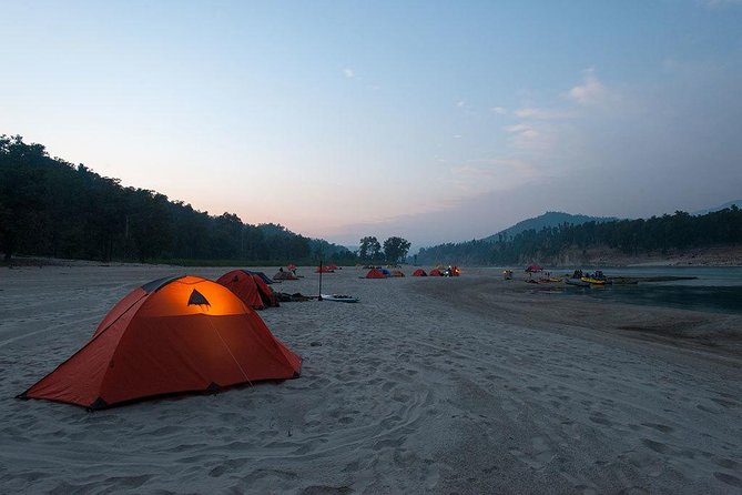 Camping is an outdoor recreational activity involving overnight stays away from home in a shelter such as a tent, a caravan, or a motorhome. Generally participants leave developed areas to spend time outdoors in more natural ones in pursuit of activities providing them enjoyment.