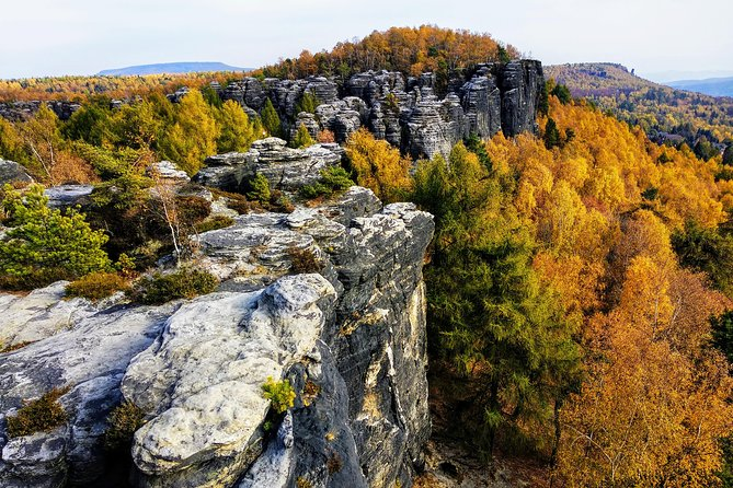 Choose our unique 12-hour day tour packed with the most fascinating historical, cultural & natural highlights of northern Bohemia. Join our small group to visit the Terezín Concentration Camp. Continue further north to reach the wonderful Bohemian Saxon Switzerland National Park. Admire the glorious Bastei Bridge and the mysterious Tisá Sandstone Labyrinth. Enjoy the lunch in the best-rated restaurant in the region, with breathtaking views. Be blown away by premium coffee and cakes served in a historical railway station café.