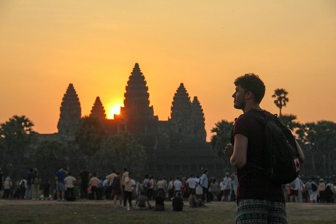 Watching the sunrise over the holies of holies, Angkor Wat temple, the world's largest religious building. The temples of Angkor are a source of inspiration and national pride to all Cambodian people, and there isn't any traveller want to miss their extravagant beauty.