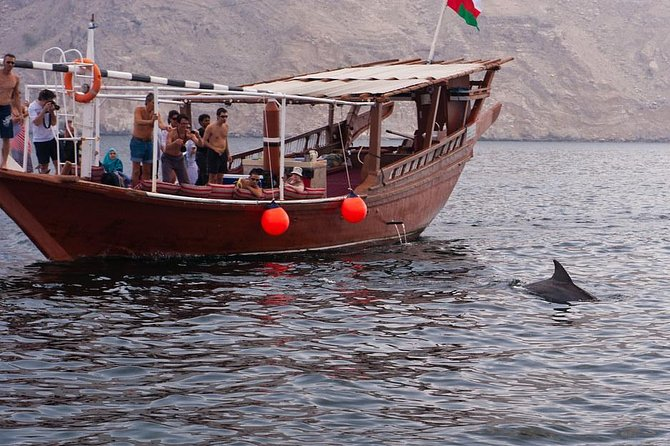 """Timing of the trip:<br>Morning: 9:30 a.m. to 1:00 p.m.<br>Afternoon: 1:30 p.m. to 5:00 p.m.<br>Khasab has something for everyone, whether you're a historian, a cultural enthusiast or an international explorer. Fjords of Musandam also known as the """"Norway of Arabia"""" has unique landscapes, mountains and sea-life. Enjoy an unforgettable day cruising through the """"Fjords of Musandam"""" on board our traditionally decorated Omani dhow, where you can sit comfortably on cushions and carpets while feasting your eyes on the striking scenery. You can enjoy the dhow ride with natural dolphins chasing the dhow during the trip. Snorkeling at Telegraph Island is also an attraction of the trip."""
