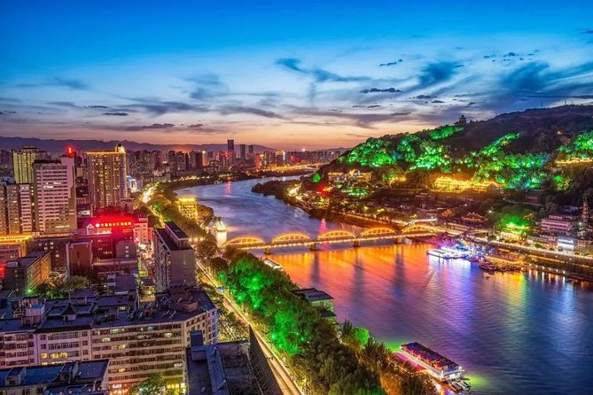 There's nothing quite like spending a magical evening in Lanzhou. On this private 4-hour evening tour, you will delight in seeing the amazing city sights all aglow. Prior to scouring the city in search of the city's illuminated beauties, experience an authentic Chinese dinner in the lively neighborhood of Food Street. Highlights during your panoramic tour include: Zhongshan Bridge, the Statue of Yellow River Mother, Xiguan Mosque, Nanguan Food Street. Finally, stroll around the Lanzhou Shuiche Park. Hotel pickup, dinner, English speaking tour guide and transport by private vehicle are included.
