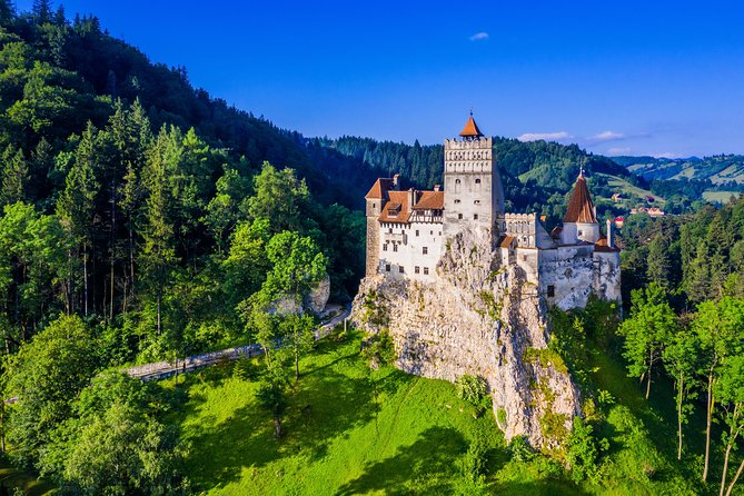 "Discover two of Transylvania's most stunning castles on this day-long adventure: Bran Castle, a 13th-century hilltop fortress known as ""Dracula's Castle,"" and Peles Castle, a masterpiece of Neo-Renaissance architecture. On this day trip, you'll be ferried by climate-controlled bus to both landmarks, and will also have the chance to wander the medieval city of Brasov."