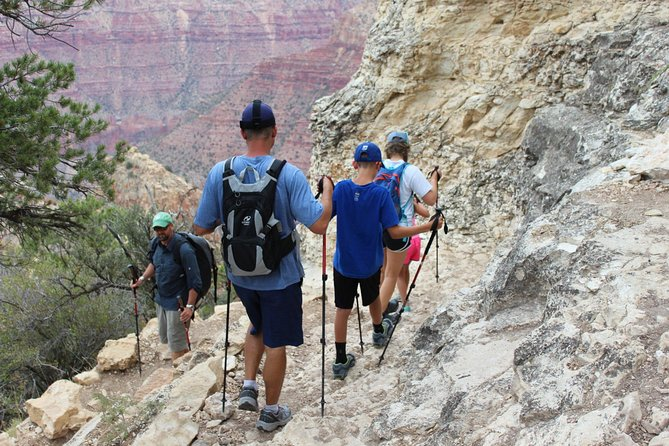 Currently the Park is not allowing us to mix groups due to COVID, so we are unable to provide this tour for less than 4 people. If you have a smaller group, please reach out to our company directly to discuss other options. This Hike can be enjoyed by guests who are fit and active. We start with an introductory viewpoint, and then into the Canyon for a fully-narrated day on the trail. Guides share their intimate knowledge of local geology, flora, fauna, biology, and history. Trail selection depends on the physical ability of the small group. Available trails: South Kaibab, Hermit, Bright Angel, or Grandview Trail.<br><br>We strive to provide everything you need to have a great day hiking. This includes lunch, snacks, water & beverages, and gear such as hiking poles, backpacks, and micro-spikes (when icy). We include transportation from all hotels, hostels, campgrounds, and many Air B&Bs in Flagstaff, Williams, Tusayan, and Grand Canyon. Pickup and drop-off times depend on your stay place!