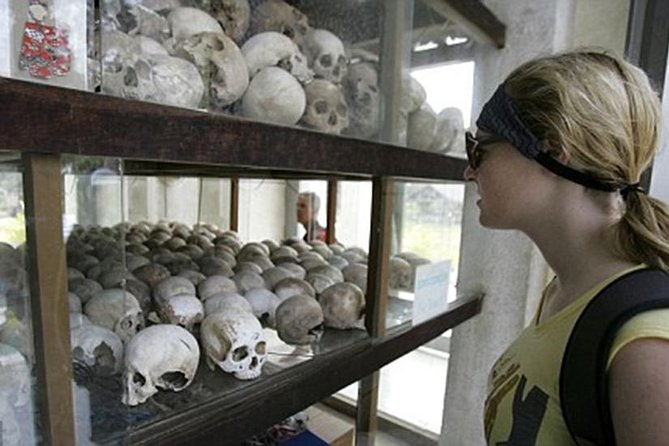 A professional English speaking tour guide will pick you up from your hotel and drive you to the<br>killing fields of Choeung Ek Genocide Center – 9 miles away south of Phnom Penh. The infamous killing fields have a bloody history. Once an orchard and a<br>Chinese cemetery, the Khmer Rouge, lead by Pol Pot, turned the place into<br>what became known as the killing fields, where they executed around 20.000 victim. Over three years they massacred and<br>buried 2.5 million people. After remembering the dead, return to Phnom Penh to visit Tuol Sleng Genocide Museum (S21). Meaning hill of the poisonous trees, Pol Pot turned a once popular<br>high school into a high security prison. 20,000 people were imprisoned<br>there, many of whom were tortured for information. Today it serves as a<br>museum and a reminder of darker days.<br>Your guide will return you to your hotel or guesthouse.you could ask any question to tour guide.<br>