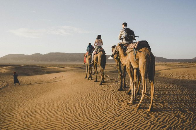 - Enjoy a ride through the High Atlas Mountains and the famous Tizi N'Tichka Pass.<br>- Visit Kasbah Ait Ben Haddou a perfect synthesis of clay architecture<br>- Discover the charming city Ouarzazate with its Kasbahs and its movie studios<br>- Visit Agdez Village and the Draa Valley and admire its palm groves and fascinating oases.<br>- Enjoy a day of dreams and discovery through the dunes of Zagora.<br>- Discover the way of living and the history of the nomads of the Moroccan desert<br>- Enjoy a camel trek at sunset and sunrise on the Zagora dunes.<br>- Enjoy a typical dinner around the fire animated by the rhythm of the nomadic drums.<br>- Spend a night camping bivouac under the starry sky.