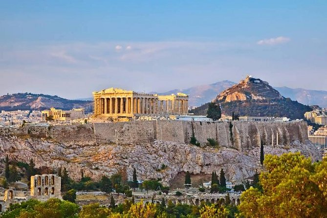 """The history of the capital of Greece starts from the 5th century B.C.<br>Ornate temples and monuments of the classical era and the Roman civilization, Byzantine churches and neoclassic buildings of the modern times form a beautiful setting that showcases the ceaselessness of the Greek culture throughout the centuries.<br><br>You will visit the Panathenaic Stadium (Kallimarmaro), where the Olympic Games took place in ancient times and the modern games were revived in 1986. You will admire buildings of extraordinary architecture, such as the """"University"""", the """"Academy"""" and the """"National Library"""" and will end up on the Acropolis. The Acropolis of Athens is the city's trademark and you will surely be mesmerized by its location, the majestic Parthenon, the Propylaea, the Temple of Athena Nike and the Erechtheion.<br><br>At the end of the tour you will have some free time. You can walk on cobblestone streets between traditional shops and neoclassic houses, at the foothills of Acropolis, in Plaka."""