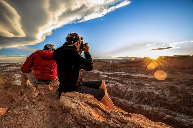 This 2-Day tour is ideal for active people that don´t want to waste any second of their trip! Venture into the Atacama Desert, one of the most hostile places in the world as we take care of your Calama airport round-trip transportation.<br><br>The world-famous Moon Valley awaits you: A natural Sanctuary, set of landscapes of incomparable beauty that resembles a fragment of the lunar landscape. To further add to your adventure, tour the place where the Earth exhales its millenary breath: The geothermal field of the Tatio Geysers. A place where the geysers and thermal waters coexist with the lowest temperatures.<br><br>Take advantage of the first lights in the morning and the last lights in the afternoon on these two tours included: Get ready to see how all the colours change in the desert! A trip you can't miss!