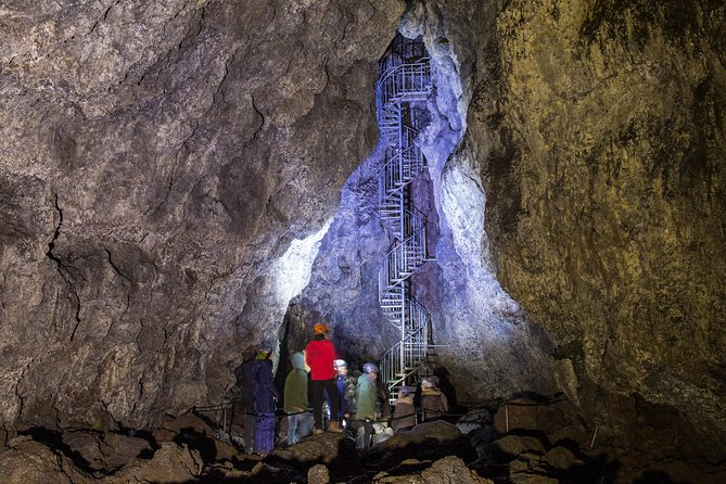 We offer 45 minute guided tours to Vatnshellir cave. It is one of the most easily accessible cave in Iceland. The cave itself is an 8000 year old lava tube created by volcanic eruption from a nearby crater in the Purkhólar crater family. As the lava rushed down the hill in a lava river it began to cool on the surface, creating a crust on top of the lava river. As the eruption stopped, all the lava from underneath this crust continued to drain out. That eventually left behind empty tube with roof on top that gradually cooled down.