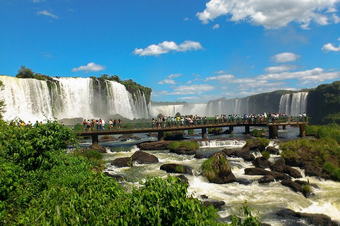 Marvel at the world-famous Iguazu Falls on this tour to the viewing area located across the Brazilian border. Don't forget your passport! <br><br>Enjoy the most spectacular panoramic views of this epic waterfall as they pour their beauty from the Argentine side of the border to the opposite Brazilian Park. Take your time to step along each walkway, feel the rain on your skin and relax. Admire the mesmerizing beauty of the 'Devil's Throat' to feel its power, one of the few experiences that will take you out of this world. Finish the walk at the amazing 'Floriano Fall', which is showcased from various viewpoints. To further add to your experience, and choosing the' Including Macuco Safari' option, embark an exciting BOAT RIDE to get a close-up view of the falls. A memorable experience!<br><br>You'll also have the option to be dropped off at a local duty-free store for tax-free shopping on the return drive.