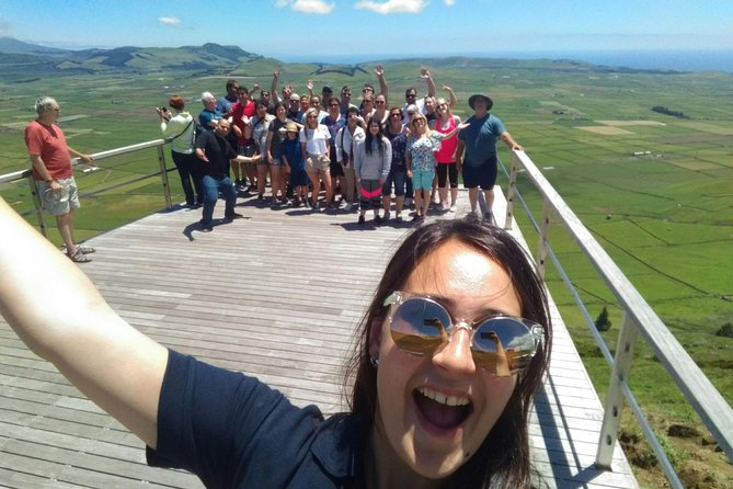 Our Full-Day Tour combines Terceira's best cultural, traditional, gastronomic, & natural richness in a complete & unforgettable tour of the entire island! <br> Your tour begins around 9 am with pick-up at your accommodation, via a modern climate-controlled van, and proceeds through all the iconic points on this little Atlantic paradise. <br>Our morning includes viewing seaside villages, centuries-old forts, amazing island views, a stop in traditional café for perhaps a café or Dona Amélia cake (traditional cake of the island) if you like, and picture opportunities of our brightly-coloured little churches called Imperios.<br>You will be charmed by our lunch stop! Enjoy traditional and exceptional island cuisine in a rustic and beautiful restaurant, that is nearly a museum on its own.<br>Our afternoon continues enjoyably around the island, viewing amazing natural wonders not to be missed! Take in volcanic coastal wonders, breathtaking inland views, perhaps enjoy the fresh air on a short nature hike, and learn about the history of important local monuments. You may even descend safely into one of the few accessible volcanoes in the world!