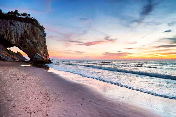 "Watch the sunset in Tusan Beach, the promontory of the rock-bound cliff looks like a horse head with its mouth in the water (the sea), Tusan Beach also famous with the ""Blue Tears"" phenomenon which is the stunning sight of glowing ocean waters."