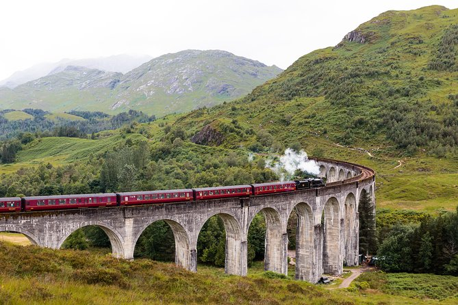 Enjoy a full-day of stunning scenery and fresh Highland air, as we travel all the way around Loch Ness and along the idyllic West Coast. Our journey reveals ancient ruins, a poignant war memorial, beautiful beaches and a hidden waterfall – with untamed mountains never far from sight. Not only will you watch the Jacobite Steam Train as it crosses the Glenfinnan Viaduct, you will later hop aboard and experience it for yourself. Made famous by the Harry Potter films, and voted one of the world's most scenic railways, this is a trip you'll never forget!