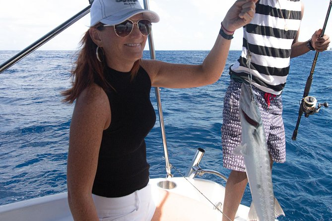 Fun custom boat bottom fishing excursions operted by grace bay adventures turks and caicos that visit outer islands, swim with dolphins, visit iguana island, sunset cruises, half and full day adventures! You will explore different fishing spots in and around the islands, lead by Captain jack with all the gear on board you will enjoy a fund day of fishing on the water. With countless offshore fishing spots you will catch groupers, snappers, barracudas and more !
