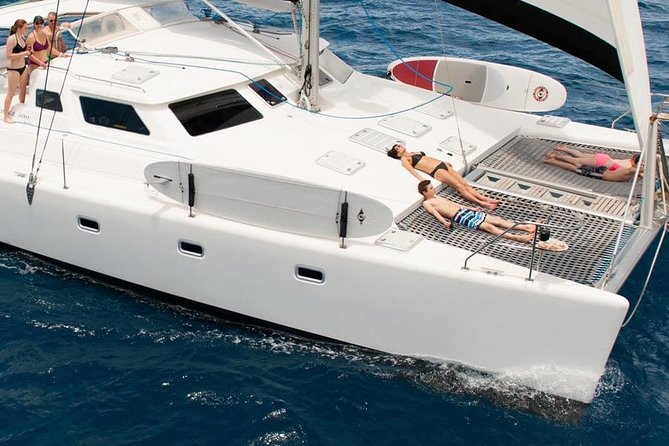 No overcrowding. This is a semi-private charter departing only from Jimmy Buffett's Margaritaville Restaurant. A maximum of 12 guests will enjoy a 4 hr sail, snorkel and beach adventure to St John. <br><br>At one of the many snorkel spots around St John (Trunk or Maho Bay) or nearby Cays (Lovango) you will have snorkeling gear to explore coral reefs that are home to an abundance of tropical fish and other sea life including swimming with turtles. Once the group is finished snorkeling, enjoy complimentary soda, beer and rum punch. <br><br>After snorkeling, we will sail you away to either Hawksnest Bay or Honeymoon Beach at Caneel Bay (weather dependent). Perhaps the prettiest beaches in the Virgin Islands, you will enjoy the white sand beach and crystal blue waters. You can visit Bikini's Beach Cafe where Pain Killers flow freely. Your experience is complete with a quick trip back to Margaritaville. <br><br>Guests will enjoy our Voyage 500 luxury sailing yacht. Departure time is 9 am or 2 pm.