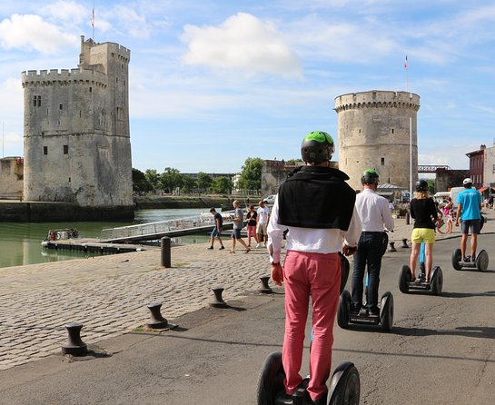 """The beautiful, coastal city of La Rochelle is known by many as """"La Ville Blanche"""" (The White City), thanks to its historic, limestone buildings. Discover the city's beautiful architecture, its thriving harbor and coastline, and other famous sights on this thrilling, 1-hour Segway tour. After a short training session on the Segway, you'll zip off with your guide on a whirlwind trip around town."""