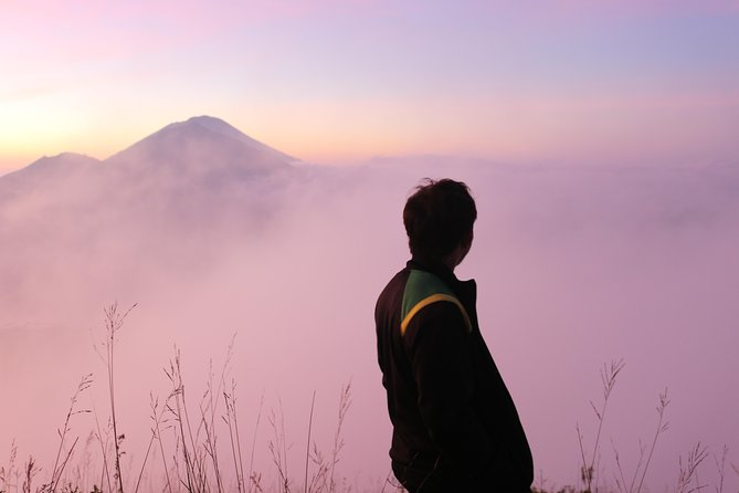 beautiful panoramic sunrise and reddish-white clouds, but the most surprising thing is you stand on the height of 1719m above the clouds..wowww amazing experince with relaxation at the natural hot spring after tired vulcano climb...enjoy the batur lake view and swim at the hot water..woow fell so relax