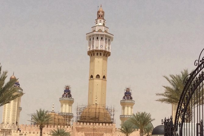 """The Holy City of Touba is very dear to the people of Senegal . It is the city of Mouridism ,and the burial place of its founder , Cheikh Ahmadou Bàmba Mbàke .<br><br>After Touba , clients will journey on to the gorgeous Lompoul Desert 145k south of Saint Louis for incredible activities such as camel trekking , sand dune buggies , and much more. During spring time the """" Festival du Sahel"""" takes places at the Limpopo desert . It's the opportunity to showcase the region's culture and music . Another great reason to go !!"""