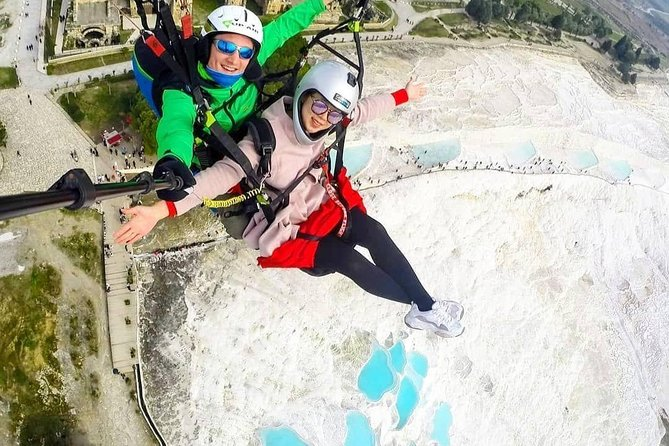 Before exploring the hot springs of Pamukkale and walking through the remains of the ancient Hierapolis, take a look at this amazing area from a height. Join a tandem paragliding to fly over the world heritage and get a unique once-in-a-lifetime experience.<br><br>After a safety briefing get ready for a memorable adventure. Professional tandem pilot will do everything in its power to give you the longest flight (up to 30 minutes). Please note that your flying time may vary from 15 to 30 minutes depending on the wind conditions. While up in the air, enjoy a gentle breeze and incredible views over the area before you. Combination of the snow-white travertines and ancient ruins is spectacular. Paragliding experience will let you to enjoy the landscape from a completely different perspective and feel the freedom of a bird at the same time. What can be more memorable than flying over the beautiful Pamukkale, which is a natural wonder and one of the world's most valuable historical sites.