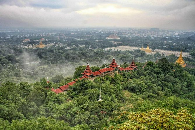 """Our itinerary is designed to visit around the Mandalay city of all attraction places within one day.Our company driver will pick up your hotel at 08:00AM.Mandalay,the second largest city in Myanmar, was established in 1857 by King Mindon. It is found in the upper part of the country, and located in the East Bank of the Ayarawaddy River. """"Mandalay"""", the city name was given by the 236-meter high Mandalay Hill. Mandaly is famous for the tourist attraction places such as Mandalay Royal Palace, Mahamuni Pagoda, Kuthodaw Pagoda, Mandalay Hill. Moreover, numerous temples and monasteries reflect the cultural and religious of Myanmar.Another tourist attraction place are industries such as tea packing, silk weaving, jade cutting, brass and copper casting, wood carvings and gold-leaf work.Besides Mandalay, Innwa/Ava, Amarapura, Sagaing and Mingun are also the ancient neighboring cities and there also have the numerous famous,sacred, and priceless pagodas, ancient monasteries."""