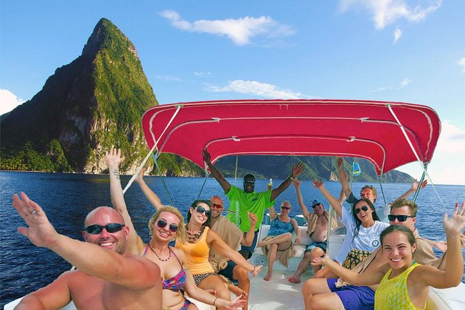 Begin this private all inclusive tour with refreshing coconut water or juice, served on the boat, as the team takes you to see the Piton Mountains, about 30 minutes. After some fun history on the island, we pause for some snorkeling at two different locations and sun bathing. Once the boat is positioned just right, allow the first mate to take your photo in front of the majestic Pitons and give your partner a kiss for the camera! A short ride to the volcano is next – the worlds only drive in volcano. On the return trip relax with complimentary beverages and grab your partner to dance to the music from our incredible sound system.