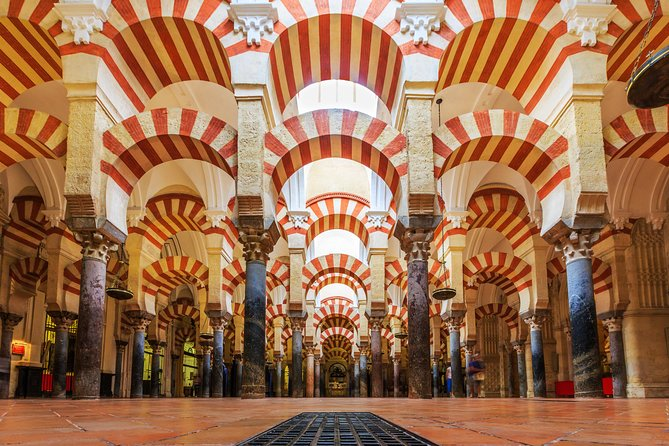 Be awed by the spectacular beauty of the Mosque-Cathedral of Córdoba on a guided tour of one of the most visited monuments in Spain.<br><br>Conserving the decorative style of an Islamic mosque, construction of the magnificent monument began in the 8th century. Later extensions vastly increased its size, turning it into the second biggest mosque in the world before it became a Catholic cathedral.<br><br>Venture inside to discover a forest of columns and elegant double arches, and admire the ornate maqsuramihrab (apse) along with other decorative highlights. Be led by an official guide to build a full picture of this landmark building. <br><br>Your tour includes Tickets, audio guide and taxes.
