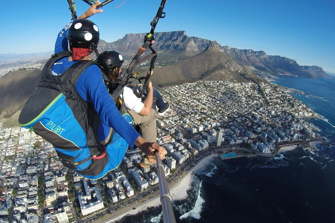 You will fly with an experienced paraglider pilot along the mountains overlooking Cape Town and the Atlantic Ocean. We will then glide out over the city and land gently on a grassy field next to the sea.<br><br>This trip offers unrivaled views of Cape Town. It is quiet, peaceful and beautiful with nothing but the feel and sound of the wind. If you want an adrenaline rush then ask your pilot for a roller coaster ride at the end, you will not be disappointed.<br><br>We fly all ages, shapes and sizes and love nothing more than to share our passion for free flying with visitors to our beautiful city.
