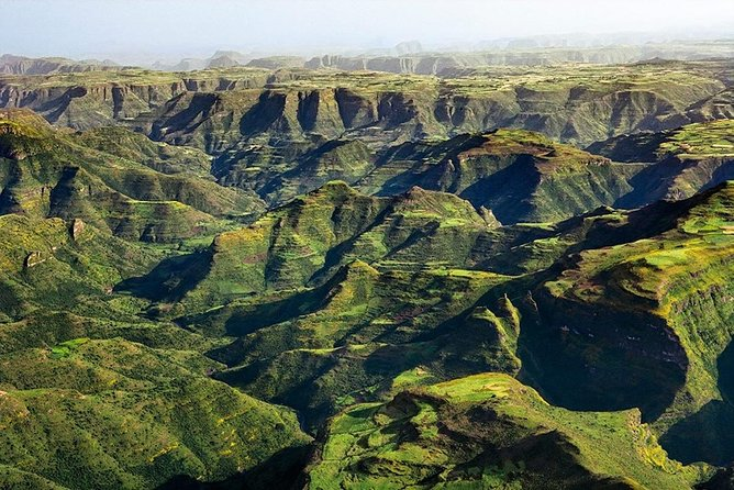 """Simien Mountains - """"Chess pieces of the gods""""<br><br>The Simien Mountains present the most dramatic mountain scenery in Africa: """"the chess pieces of the Gods"""" as one writer described them, tower over precipitous gorges, river valleys and plains stretching all the way to Eritrea."""