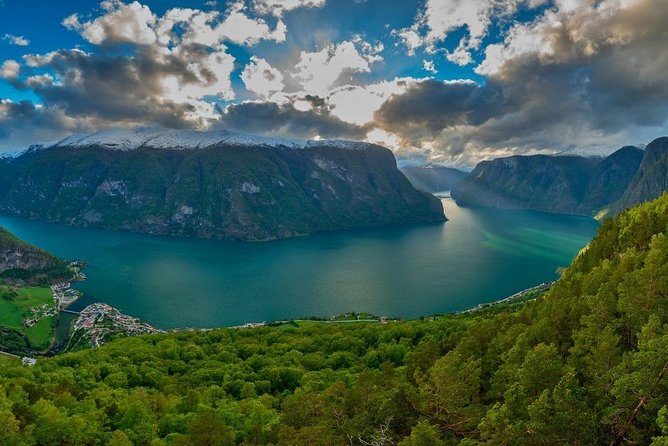 On this amazing sightseeing tour from Flåm on a minivan with a private driver-guide, you will explore the natural wonders of the Norwgian Fjord landscape are – inscribed into the UNESCO World Heritage list, and visit Njardarheimr – a reconstructed Viking Village with real modern day Vikings.<br><br>You will first stop at Stalheim hotel to enjoy the view of the stunning Nærøydalen valley, then take a drive down the Stalheimskleiva hairpin turn road (open May–September) and walk up close to the Stalheimsfossen waterfall.<br><br>In Gudvangen you can to witness the gorgeous Nærøyfjord – one of the two UNESCO World Heritage fjords, and visit the Vikings, learn about their history and culture.<br><br>After Gudvangen, on to the famous Stegastein viewpoint above the Aurlandsfjord. A thrilling ride on a hairpin turn road takes you to an elevation of 640 meters / 2099 feet above sea level. The view is stunning!<br><br>From Stegastein you retunr to Flåm, where the tour ends.<br><br>Duration of the tour: 4-5 hours.