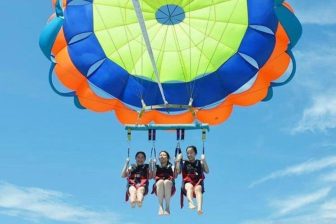 Bali Parasailing adventure is a Bali Water Sports Tour package to experianced The best watersport in Bali Islands. The parasailor is strapped into a harness which is attached to the parasail canopy and connected to the speed boat via a rope and watersports parasailing for 1 round. This experiance is Safe and Fun!