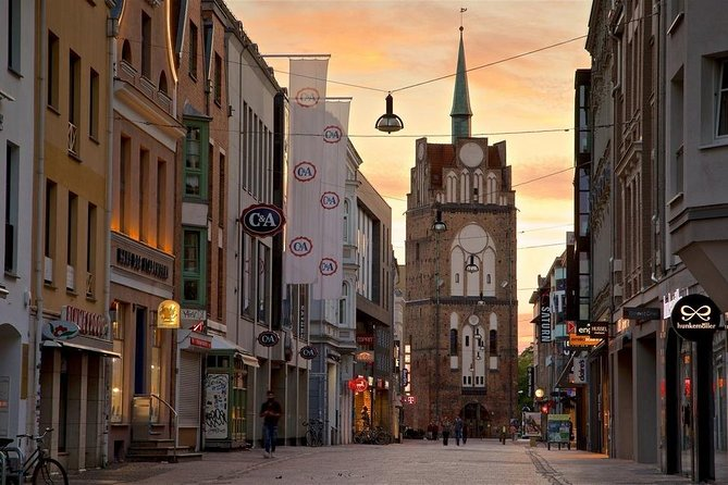 Warnemünde panoramic tour (1 hour) and walking tour of Rostock old town (4.5 hrs). <br>Meet your guide and driver by the ship and start your 1-hr panoramic tour of Warnemünde, after which you will travel by car to Rostock where you will see the Kröpeliner Straße and the Kröpeliner Tor, the New Market Square, the Rostock City Wall and gates, the Town hall, St. Marien Church, the University, etc. Then return to Warnemünde by car.<br><br>• Guaranteed skip-the-line entrance