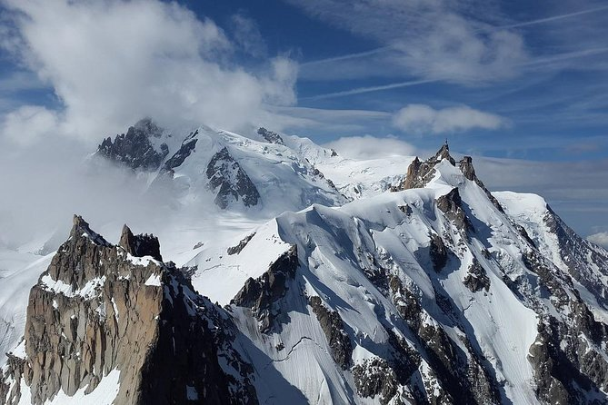 """Experience Mont Blanc offers the opportunity to discover one of the most beautiful places in Chamonix ! The Aiguille du Midi, an iconic place that welcomes millions of tourists every year.<br><br>In only 20 minutes and two cable car rides from the center of Chamonix you'll arrive at 3842 meters on top of some of the highest peaks in the Alps. Jaw-dropping 360° views of the French, Swiss and Italian Alps, close enough you could almost touch them. Emotion and memories guaranteed !<br><br>For the daring, visit the recent and exhilarating attraction """"Step into the Void""""! A 5 sided glass box suspended 1000 meters above the peaks.<br><br>This is also the starting point for those who will attempt to conquer the Mont Blanc, or the starting point for the exciting descent of the Mer de Glace ski glacier experience.<br><br>Your enthusiastic mountain guide will teach you everything you'll want to know about the peaks – aiguilles as they are called in French, summits, the tetra a local bird, the glaciers and much more."""