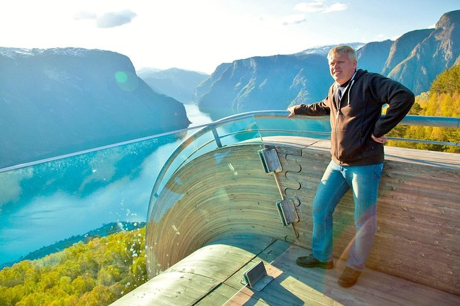 On this amazing sightseeing tour from Flåm on a minivan with a private driver-guide, you will explore the natural wonders of the Norwgian Fjord landscape are - inscribed into the UNESCO World Heritage list.<br><br>You will first stop at Stalheim hotel to enjoy the view of the stunning Nærøydalen valley, then walk up close to the Stalheimsfossen waterfall, before coming to the charming village of Gudvangen.<br><br>In Gudvangen you can to witness the gorgeous Nærøyfjord – one of the two UNESCO World Heritage fjords. Here you can also visit a real modern day Viking Town (optional).<br><br>After Gudvangen, on to the famous Stegastein viewpoint above the Aurlandsfjord. A thrilling ride on a hairpin turn road takes you to an elevation of 640 meters / 2099 feet above sea level. The view is stunning!<br><br>Duration of the tour: approx. 4.5 hours. You may choose to visit the Viking town or have more time on our scheduled stops to soak up the natural beauty of the western fjords.