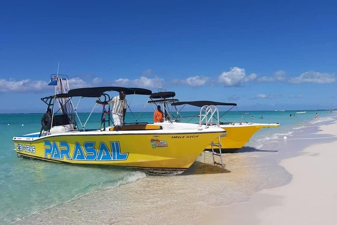 We are TCI's premiere parasail operator. With over 200,000 safe flights flown since 1991, our skilled and professional crew are by far among the most experience in the business. This is our 29th year in business. As an Owner/operator Capt. Marvin Pratt has been flying since 1990,with 29 years experience.Our other captains all have over 10 years experience flying in various locations.We have (2) 1999 Premium Custom 28' USCG certified (12) passenger parasail boats and our third Parasail boat , a USCG certified (12) passenger 31' Ocean Pro by CWS Boats. Our boats are designed specifically for parasailing. Whether you are by yourself or a large group we are more than happy to take you to new heights. A TCI Owned and Operated Company, we are first in experience, first in service and first in safety, with state of the art clean quality boats, friendly staff and family focused service.