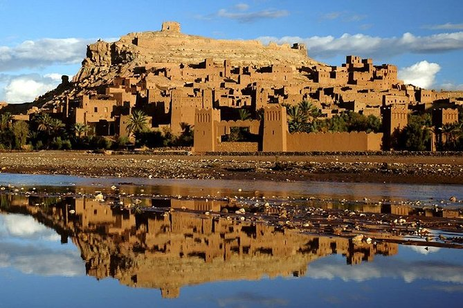 Visit Ait Benhaddou village (where Star Wars were filmed). UNESCO as one of the world's cultural treasures has classified the fortified village of Ait Benhaddou. It is studded with crenelated towers and its buildings decorated with geometrical motifs and are considered to be one of the most beautiful villages of this kind in Morocco. A program of restoration work is currently under way to encourage the population of the village, which is at present inhabited by just five families.<br><br>From here, continue to Ouarzazate, which marks the beginning of the Sahara desert. Visit Taourirt Kasbah. This former Glaoui residence, situated on the edge of the town, on the road to Morocco Sahara desert, is considered to be one of the most beautiful kasbahs of Morocco. It consists of a maze of luxury apartments, simple clay houses and crenelated towers, which are lavishly decorated with geometric motifs. Part of the fortified village is open to the public.<br><br>