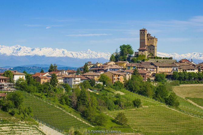 Let us take you on the most panoramic routes winding through the area of production of the famous Barolo wine, in this half-day tour including the visit of an off-the-beaten-track winery and a tasting of four premium wines and comparison of different types of Barolo. <br><br>Take advantage of stunning photo opportunities over these hills which are part of the 50th UNESCO World Heritage site of Italy, as you discover medieval castles, hill-top hamlets and scattered farmhouses. <br><br>In the end, stop in the must-see town of Barolo or another town in the area, for some shopping opportunities in the numerous wine shops.<br><br>With transport included: up to 3 guests we may book the guide's car, then from 4 guests and more we will book a professional driver (NO guide).<br><br>With transport not included: the guide is always with you and he/she will come on your vehicle.