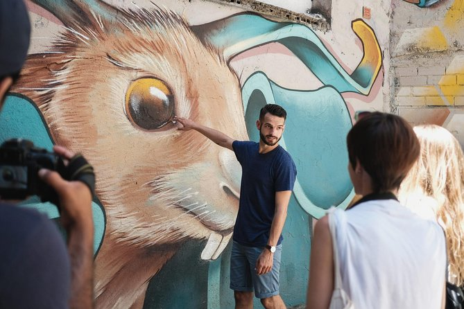 Set off on a colourful adventure into the world of street art in El Raval— one of the city's most alternative, exciting and infamous neighbourhoods. We'll journey though the best street art spots and uncover the secret messages behind the hidden artworks, learn all about the artists, graffiti culture, and the stories that make up Barcelona's famous street art scene<br><br>Along the way we'll visit the city's most famous mural by New York artist Keith Haring, it's oldest graffiti (over 400 years old!) and head to Barcelona's biggest Urban Art Gallery where we can sometimes find the artists working away in the gallery's underground studios.<br><br>Taking you truly behind the street art scenes and to round off our experience, we'll head to our Underground Art Hub—a private space filled artwork from some of the city's best emerging street artists. We'll share some drinks and snacks together and give you tips on great places to eat & drink, and off-the-beaten-track places to visit and things to do. <br><br>
