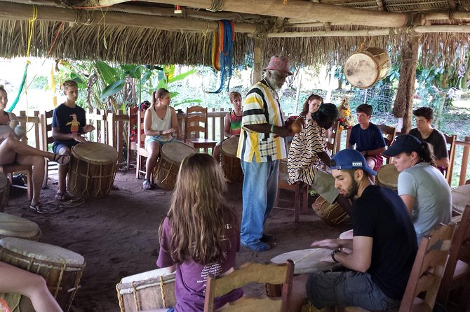 Spend the morning or afternoon delving into the history, people, music & food of the Garifuna culture on this half day tour. Meet your guide at Warasa Garifuna Drum School in Punta Gorda and step inside our open-air thatched palapa and learn about enjoy a one-hour drumming lesson. Learn about Garifuna drums and history and how to play up to 6 rhythms on the segunda drum. Play with your host, who will play the faster-paced primero drum while singing traditional songs. Afterwards, enjoy a group dancing lesson and about the different dance moves that accompany the rhythms you just learned to play. Next enjoy a 30 minute professional performance by your host and his talented, welcoming family group.<br><br>Finally, sit back & savor a traditional Garifuna lunch of hudut - fresh fish fillet sautéed in handmade coconut milk and lightly seasoned with cilantro and other herbs, served with mashed plantain. Vegetarian/vegan variation can be provided! Naturally gluten and lactose free.