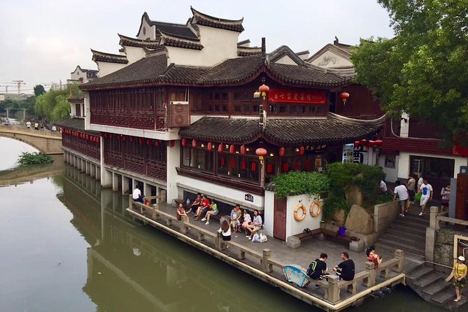 This tour provides a great opportunity to explore must-see attractions of Shanghai. With the assistance of our professional guide, we will get an overview of the city, enjoy the night scenery along the Bund and hear about its history at Qibao Old Street and Former French Concession. The itinerary includes Qibao Old Street, Shanghai Zoo, Former French Concession, Xintiandi, Oriental Pearl Tower and the Bund. <br><br>1.This tour can be customized based on your interests.<br>2.Stroll on Qibao Old Street, taste typical snacks and enjoy the local lifestyle.<br>3.Observe the giant panda and other animals up close.<br>4.Experience the historical and cultural atmosphere of the city in Former French Concession and Xintiandi.<br>5.Visit the 26 various buildings of different architectural styles along the Bund.<br>6.Metro travel as local.