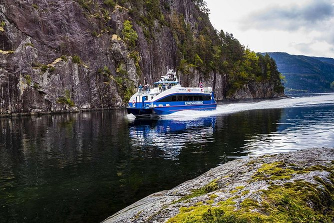 Join our round-trip cruise from Bergen in spectacular fjord scenery. This fantastic tour takes you up the 27-kilometer long Osterfjord. Underway, the fjord narrows between steep mountains as we bring you safely through the powerful currents of the shallow and narrow Mostraumen strait. We sail our bow right up to a waterfall to catch a bucket of ice-cold mountain water for you to sample before turning back and returning to Bergen through the magnificent landscape. Our modern, comfortable boats have sundecks and kiosks offering refreshments, including beer and wine. <br><br>Departure from Zacharias Bryggen / Fish market in Bergen