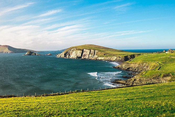 """The Dingle Peninsula has amazing mountain scenery and unusual antiquities to see as you travel around this spectacular peninsula. You will stop at the famed Inch beach, one of the most famous beaches in Ireland, which is a site of outstanding natural beauty. <br><br>Then to the most westerly drive in Europe known as the Slea Head drive. Marvel at the Atlantic Coast as you travel on this spectacular road which hugs the western shoreline. Enjoy great views of the Blasket Islands and maybe even see the """"Sleeping Giant Island.""""<br><br>You will also stop in Dingle town. This is one of the most picturesque fishing towns in Ireland, and is also famed for Fungi the dolphin who has been a local for almost 30 years. Dingle town is the heart and soul of the Peninsula. Today is attracts visitors, including artists and musicians, from all over the world."""