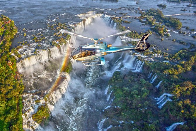 Fly over Iguassu Falls, one of the most dramatic and picture-perfect waterfalls in the world. Bring your camera and get ready to be awed by the jaw-droppingly stunning views as your helicopter floats above the falls, which are 270 feet (82 meters) high. This 10-minute helicopter tour offers a lifetime of memories for its fantastic panoramas over the Iguassu Falls and the surrounding wilderness.