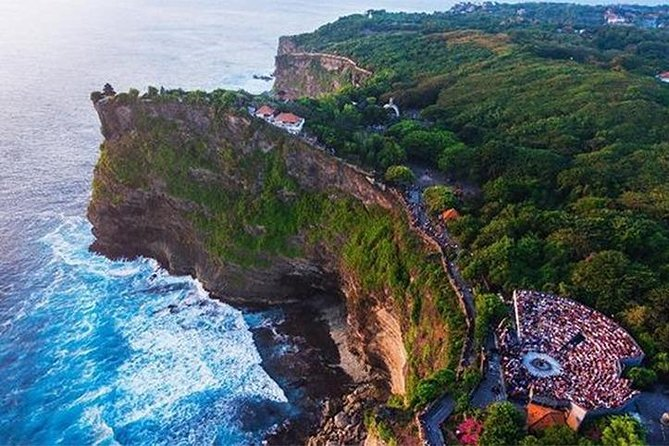 Experience Bali's traditional culture on a 4-6-hour tour to Uluwatu Temple with a dance performance. Enjoy stunning views of the ocean from an ancient cliff side temple, and watch surfers catch waves at a renowned break. See a Kecak performance where Balinese dancers act out the story of the Ramayana while chanting around ceremonial flames.<br><br>- Free pick up and drop off hotel at Seminyak, Kuta, Legian, Kerobokan, Sanur, Nusa Dua, Jimbaran and Uluwatu<br>- Visit coffee plantation, may you would try some of Balinese coffee ( Bali coffee,luwak coffee atc )<br>- Explore the Uluwatu cliff view temple<br>- Watch the Balinese traditional dance (Kecak & Fire performance dance) with amazing sunset, performance will be start from 6 to 7pm