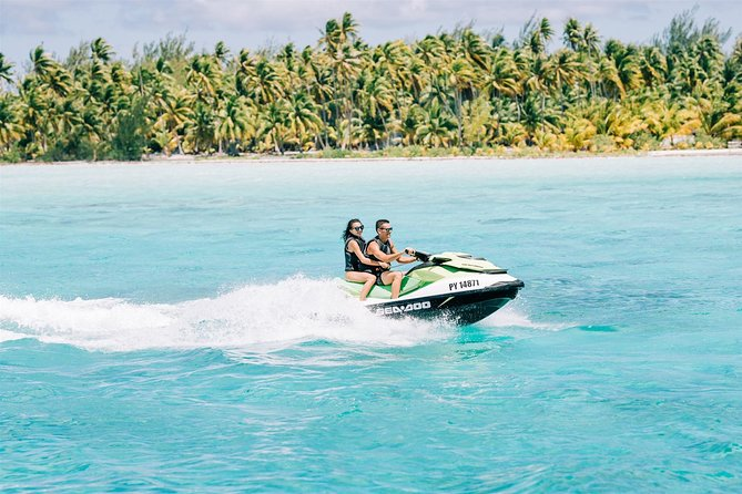 Zip around the turquoise lagoon of Bora Bora's on a Jet ski tour with an experienced guide. Have some adrenaline-fueled fun as you cruise in warm waters, taking in the rugged slopes of Mount Otemanu, lush greenery and crystal-clear waters of this Polynesian paradise. Your tour includes a short stop for swimming and a coconut husking demonstration, along with plenty of postcard-perfect photo ops.<br><br>FYI: Jet ski driver minimum 16yo, Participant minimum 11yo. 4 jet skis per guide