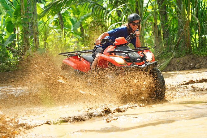 Enjoy the beautiful scenery of the Northern Bali Highlands while on a 2-hour ATV ride with a local ATV guide. This small-group tour features riding through a Balinese village, local temples, beautiful rice terraces, jungle tracks, creeks and more. You'll also see some of the rural Balinese activities such as kids playing outdoors and waving to you or farmers working on their land. Your tour includes return hotel transfers and a light lunch after the activity.<br><br>Choose the add-on option to include tour with private car to Tibumana waterfall and Tegenungan waterfall for swimming, sightseeing or taking nice photo for instagram .